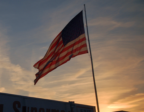 US flag at sunset